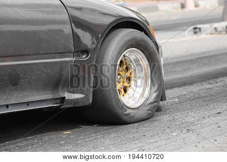 Front wheel drive drag racing car at start line .