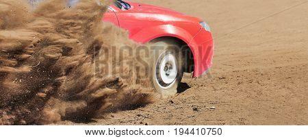 Rally racing car splash dust  in track .