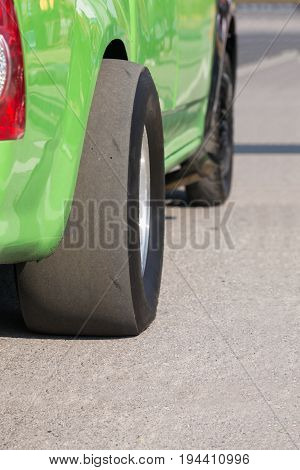 Drag racing slick tires in track .