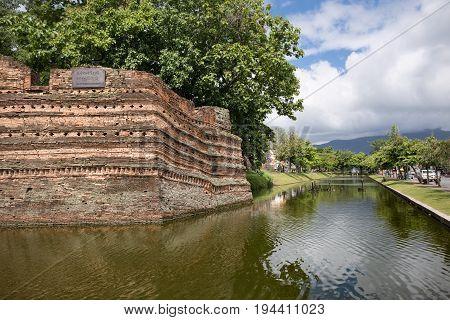 Ancient Chiang Mai moat and ancient wall .