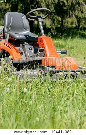 Work In The Garden. Lawn Mower Cutting Green Grass In Backyard.
