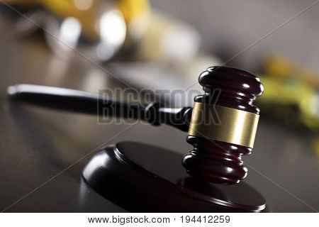 Construction law theme. Gavel and helmet of the constuctor.