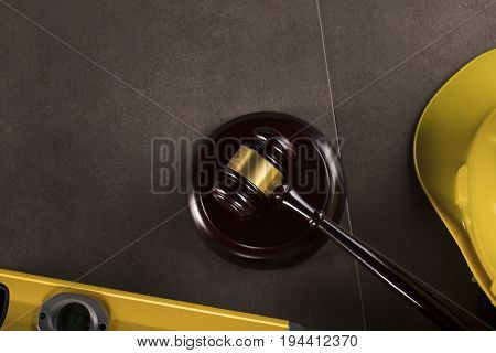 Construction law, law symbols - gavel. Stone table.