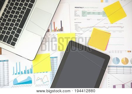 Top View Office Workplace With Laptop On Wood Table Showing Business And Financial Report Accounting