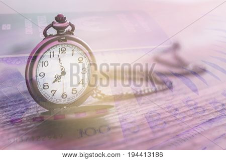 pocket watch over yuan banknotes with double exposure effect time is money business and finance concept