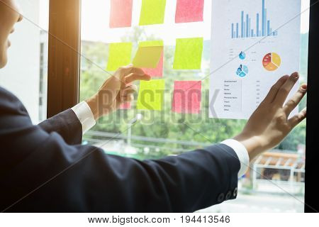 Close Up Businessman Hand Holding Note Paper Meeting Working In The Office, Use Post It Notes To Sha