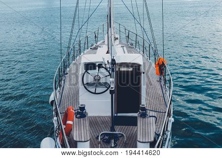 Sailing Yacht In Sea. Yacht's nose On Azure Sea Water Travel Cruise Vacation Concept