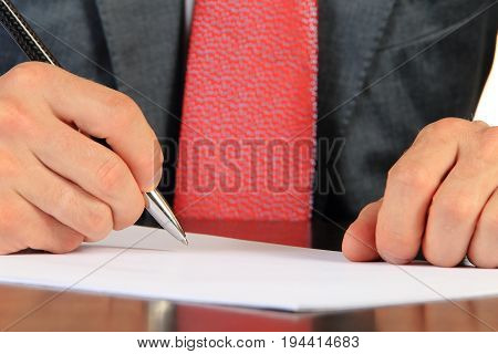 Businessman sign documents close-up. Close-up of shiny pen in businessman hand. Business concept.