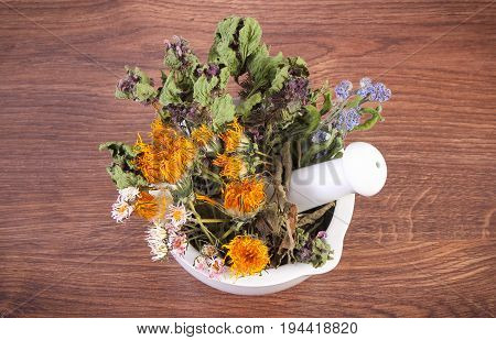 Dried Herbs And Flowers In White Glass Mortar, Herbalism And Decoration Concept