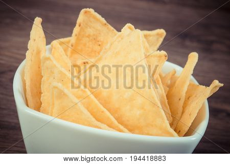 Vintage Photo, Salted Potato Crisps In White Glass Bowl, Concept Of Unhealthy Food