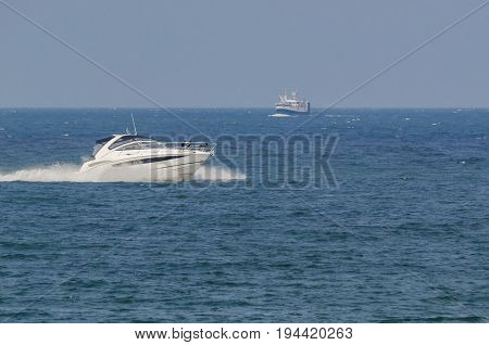 MOTOR BOAT - Fast boat on a cruise on the sea