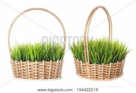 Grass in wicker basket isolated on white background