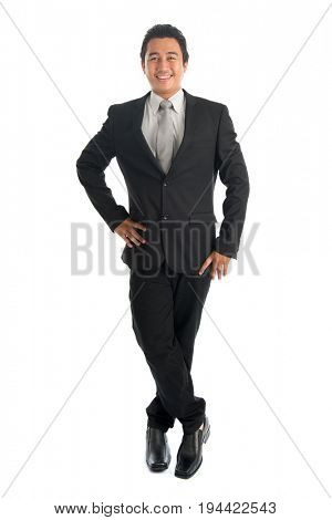 Full body portrait of happy young Southeast Asian businessman standing isolated on white background.