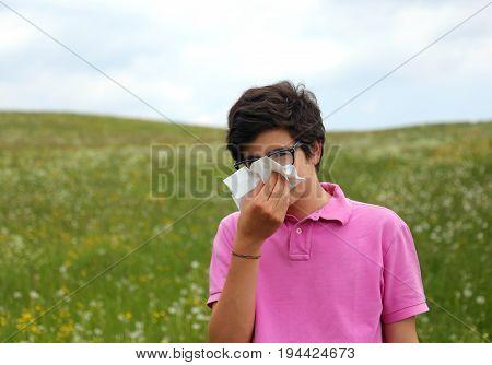 Allergic Boy Blows His Nose With White Handkerchief In Springtim