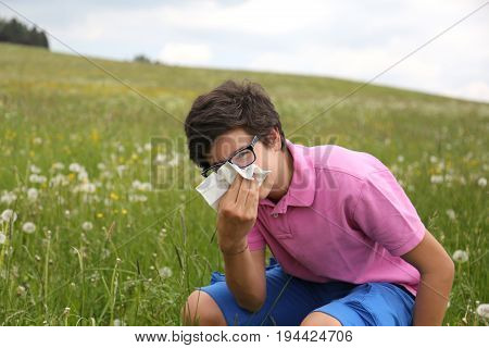Allergic Boy With Glasses Blows His Nose