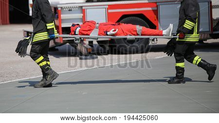 Firefighters During The Exercise To Carry The Injured With The S
