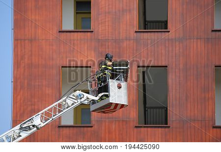 Firefighters During Exercise In The Firehouse And The Building