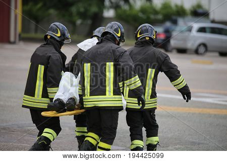Firefighters With The Stretcher After A Tragic Road Accident