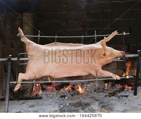 Skewer Of A Large Roasted Roasted Pork With Slow Fire