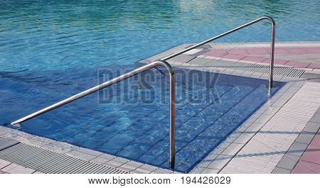Swimming Pool With Ladder And The Steel Handrail In An Exclusive