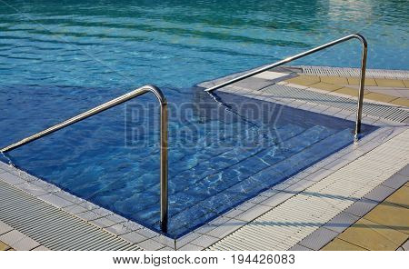 Steel Handrail To Access The Pool For Muscle Rehabilitation At A