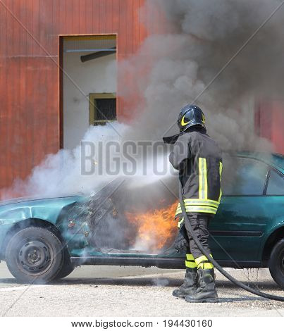 Car With Flames And Black Smoke Firefighter Intervening To Tampe