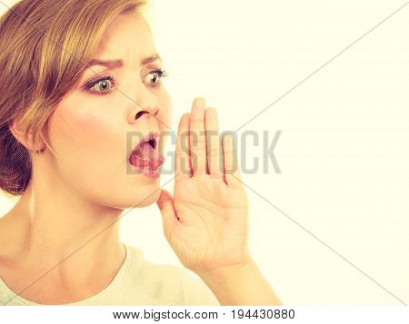 Woman Whispering With Hand Close To Mouth