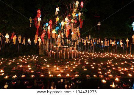 Buddha image at night of Buddhist major lantern festival day in Wat Phan Tao temple at chiang mai Thailand