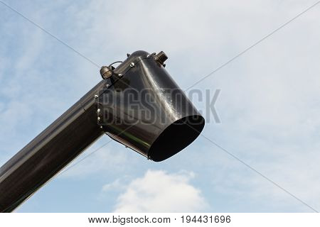 Black Chute Or Drainpipe With Sky In Background