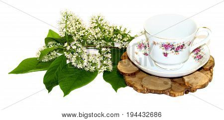 A Bouquet Of Fresh Sprig Of Lily Of The Valley Near A Tea Pair From A Saucer Cup Of Tea On A Juniper