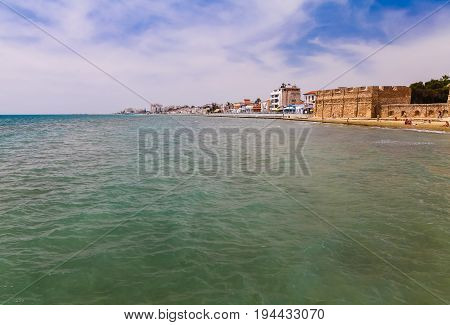 LARNACA CYPRUS - MAY 29 2014 : View of Larnaca seafront (Embankment) from pier. Larnaca - is a city on southern coast of Cyprus island.