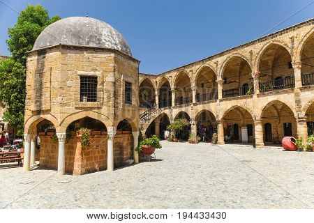NICOSIA NORTHERN CYPRUS- MAY 30 2014 : View on Buyuk Han (the Great Inn) largest caravanserai in Cyprus. Nicosia