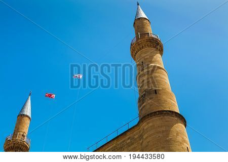 NICOSIA NORTHERN CYPRUS - MAY 30 2014: View on Northern Nicosia symbol - steeples of Selimiye mosque (ex. St. Sophia Cathedral)