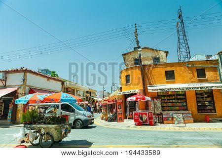NICOSIA NORTHERN CYPRUS- MAY 30 2014 : View on the part of local market truck with flowers and small shops in Nicosia