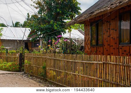 Rural Road With Houses In The Philippines. Pandan, Panay