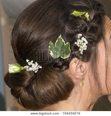 Chignon made by hairdresser for the bride for the wedding