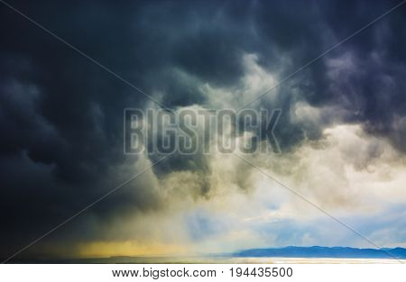 Dark storm clouds over the sea. Dark storm clouds over the sea. storm at sea