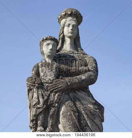 statue of the Virgin Mary with the baby Jesus Christ (Religion faith eternal life God the soul concept)