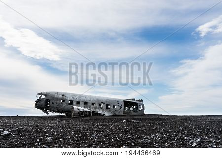 Abandoned plane wreck on the desolate Sólheimasandur black sand beach