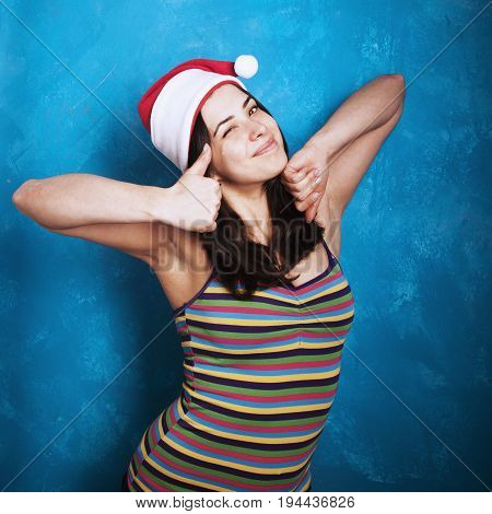 Beautiful woman in the Santa Claus making a perfect gesture with her fingers (Gestures body language psychology)