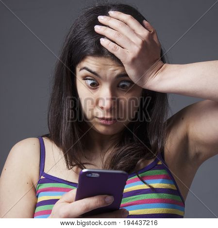 Nervous woman swearing into his mobile phone. The bad news negative emotions concept.