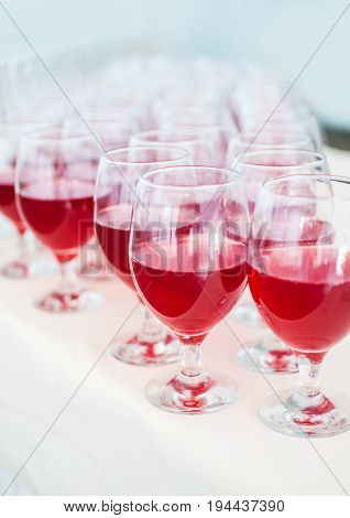 catering services. glasses with wine in row background at restaurant party. Selective focus