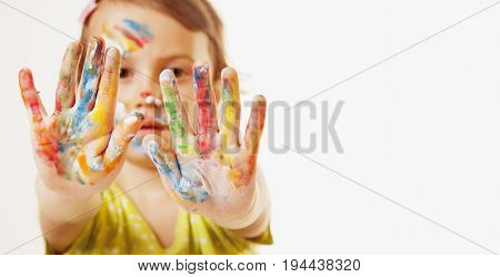 Colorful painted hands in a beautiful young girl (art happy childhood colour concept)