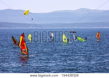 Brac island, Croatia - July 8, 2017: Windsurfing on Adriatic sea, Croatia, Brac island