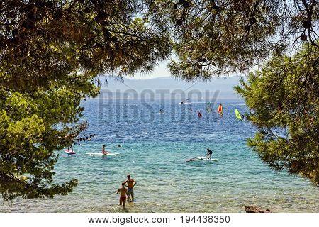 Brac island, Croatia - July 8, 2017: Beach of Adriatic sea, Croatia, Brac island