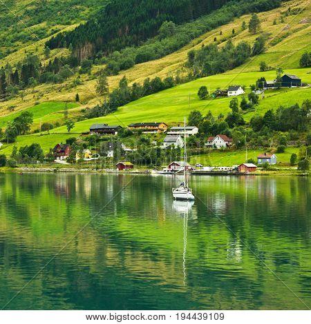 Norwegian fjords in sea port Olden, Norway.