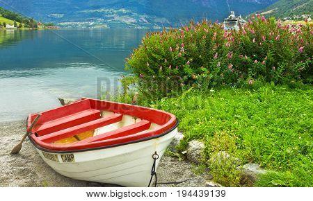Boat on the beach of Norwegian village Olden, Norway.