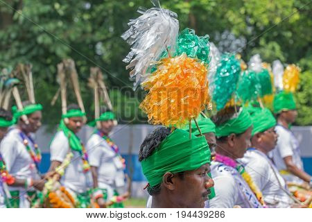 KOLKATA WEST BENGAL / INDIA - AUGUST 15TH 2016 : Folk dancers marching past in India's Independence day rally with musical instruments in their hands. The day in celebrtated all over India with joy.