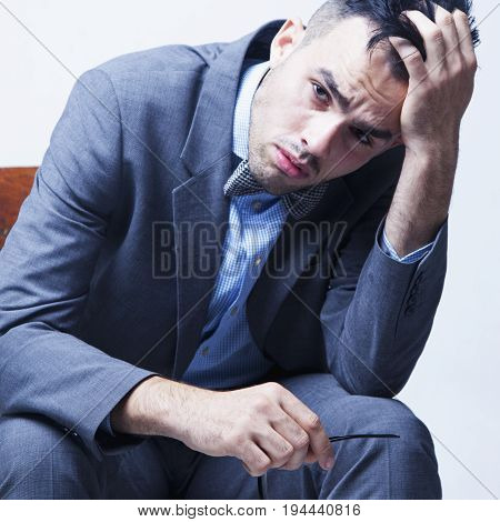 Problems in business. Young nervous businessman with worried expression