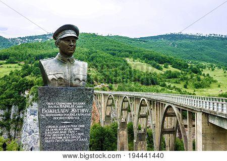Tara, Montenegro - May 7, 2017: Monument for builder of Durdevica Tara arc bridge - Bozhidar Zhugik Montenegro. One of the highest automobile bridges in Europe.